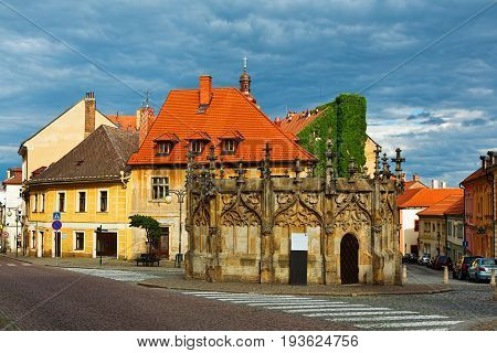 KUTNA HORA CZECH REPUBLIC - JULY 03 2016: Medieval well in the middle of an old town