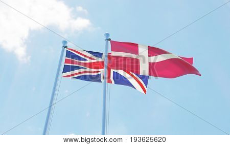 Great Britain and Denmark, two flags waving against blue sky. 3d image