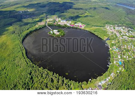 Aerial view of Vvedenskoe Lake with small island with monastery in Pokrov Vladimir Oblast Russia