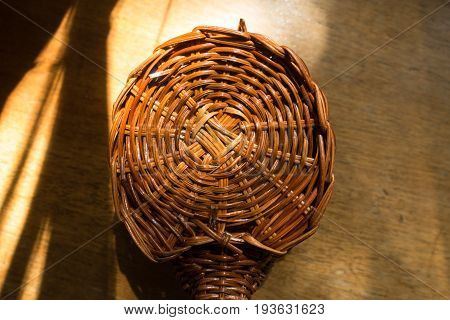 Small Wickerwork On Wooden Table From Above
