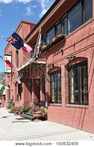 CODY, WYOMING - JUNE 24, 2017: The Chamberlin Inn. the historic hotel and landmark, has 21 units made up of a series of suites, rooms, cottage and garden studios.