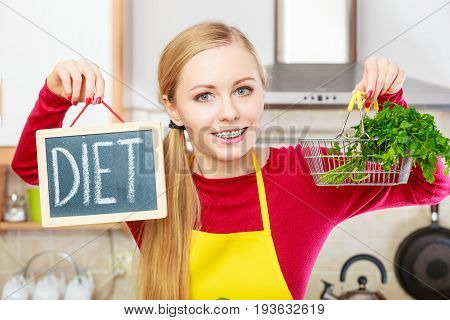Woman Holding Diet Sign And Shopping Basket With