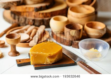 a piece of beeswax preparing for treating handmade wooden dishes