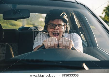 man driving car in helmet with horror on her face, learning driving