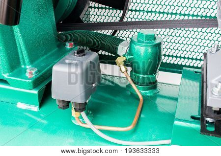 The Control pressure switch, for reduce pressure of air compressor.