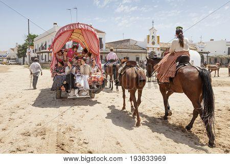 El Rocio Spain - June 2 2017: Pilgrims with a donkey cart in El Rocio during the Romeria 2017. Province of Huelva Almonte Andalusia Spain