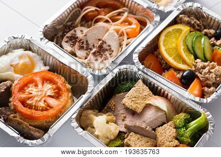 Healthy restaurant meals take away and delivery. Diet concept. Everyday dietary menu, meat with garnish and vegetable salad in take away boxes, background