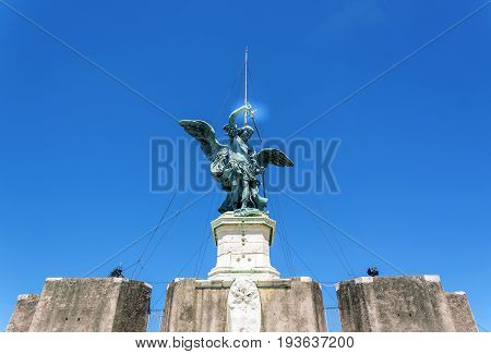 Bronze Statue of the archangel Michael on top of Castel Sant Angelo (castle of the holy angel) in Rome Italy