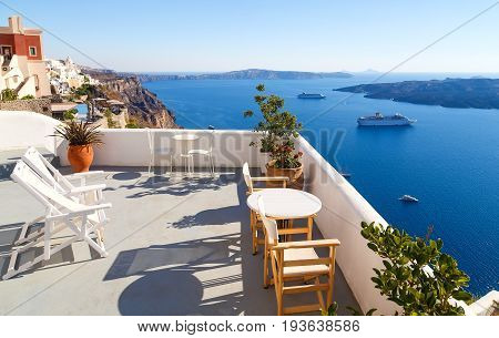 Breathtaking view of the caldera from a balcony in Imerovigli, Santorini, Greece.
