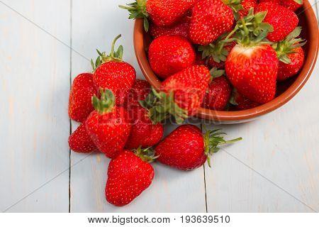 a bowl of fresh ripe summer strawberries