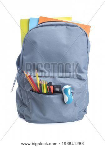 Grey backpack with school supplies, isolated on white