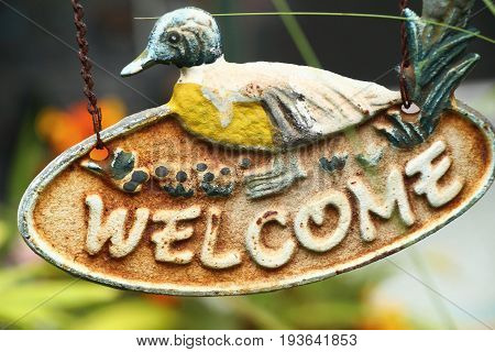 Symbolize welcome on background with the nature