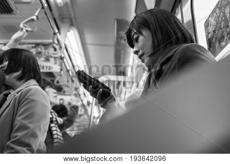 TOKYO, JAPAN - NOVEMBER 12, 2016: People traveling by very popular Tokyo Metro in the capital of Japan. Tokyo Metro had an average daily ridership of 6,84 million passengers.