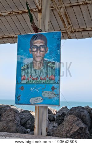 Hormuz Island Hormozgan Province Iran - 17 april 2017: The portrait of a soldier who died during the war between Iran and Iraq is located under a canopy near the pier.