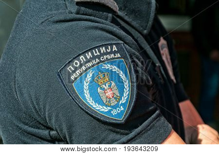 Shirtsleeve with emblem of Serbian police. Translation - Police, Republic of Serbia. March -26. 2017. Novi Sad, Serbia.