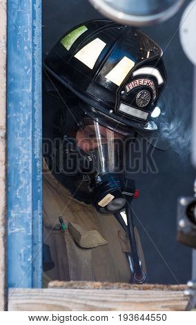 Firefighter Training Man Standing In A Smoky Window