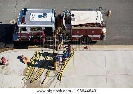 Firefighter Training Manning The Truck Overhead View