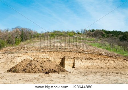 Excavation site. Preparation of terrain for construction of houses in the countryside.