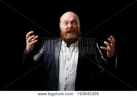 Angry adult man with tense hands