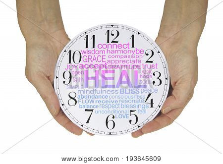There is always time for Healing - female hands holding a clock face containing a pink and blue graduated HEAL word cloud  isolated on a white  background