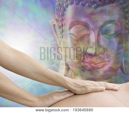 Totally Relaxing Mindfulness Body Massage - Female hands gliding up male back with an ethereal meditative Buddha head in the background and copy space