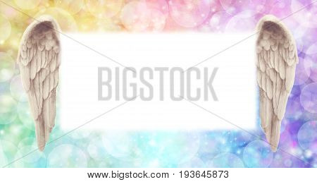 Rainbow Angel Wings Message Board   -   wide  ethereal rainbow colored bokeh effect background with a large misty white central message board area  flanked by a pair of Angel wings