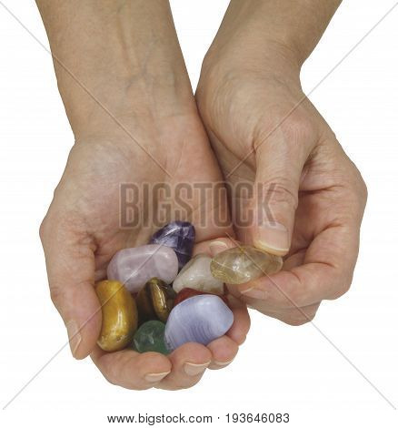This one is a Rutilated Quartz -Crystal healer holding a selection of crystals in cupped hand offering a rutilated quartz isolated on a white  background