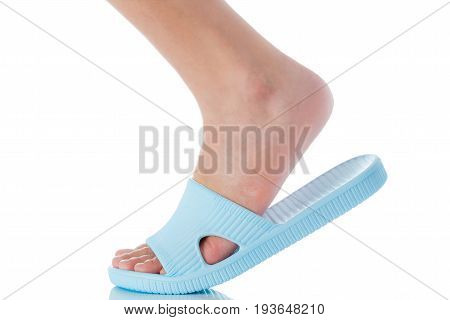 Woman foot wearing beautiful blue sandal step with side view on white background Fashion woman concept.