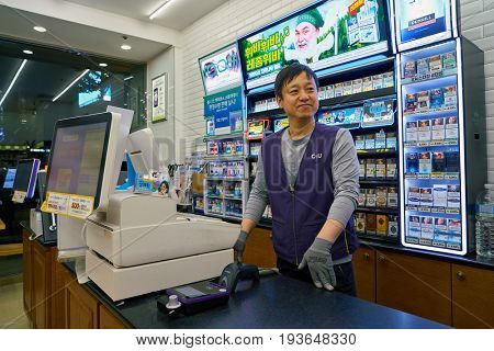 SEOUL, SOUTH KOREA - CIRCA MAY, 2017: worker at CU convenience store. CU is a convenience store franchise chain in South Korea.