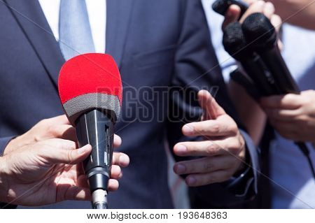 TV or media interview with politician or business person