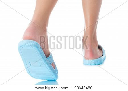 Woman feet wearing beautiful blue sandal step with back side on white background Fashion woman concept.