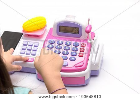 Little Girl Fingers Pressing Toy Calculator