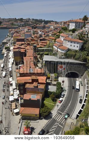 PORTO, PORTUGAL - AUGUST 7, 2015: Aerial view of Ribeira Square and the surrounding district seen from the top of Dom Luiz bridge in Porto Portugal