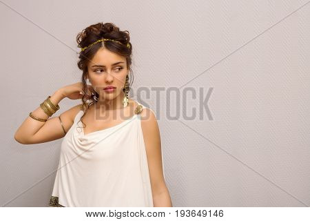 Portrait Of Beautiful Young Greek Woman In Antique White Toga, Looking Side, With Copy Space