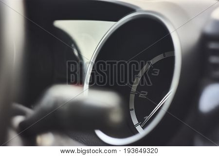 Tachometer with an Italian car hand. Illustrative detail.