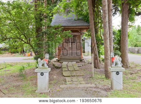 DAISEN JAPAN - MAY 26 2017: Small worship hall of Inari Shinto Shrine with kitsune fox guards. Located on the grounds of Naganobeyama Daisen Buddhist Temple in Daisen Akita Prefecture Japan