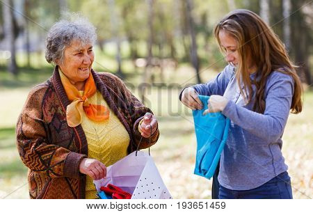 Photo of happy elderly woman with her daughter