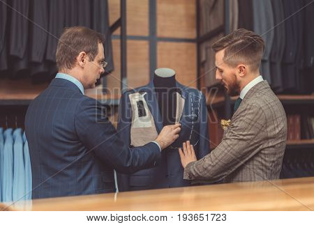 Customer and tailor in studio