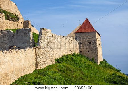 Rupea Romania - June 23 2013: Old medieval fortress on top of the hill Rupea village located in Transylvania Romania