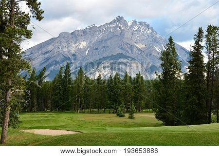 Beautiful mountain landscape with a golf course hidden inside.
