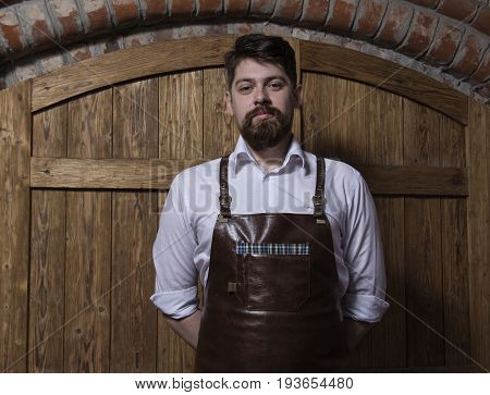 Portrait of cheerful  bartender standing  in bar