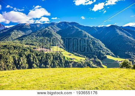 Rural pastoral in the Val de Funes, Dolomites. Warm autumn day. The slope of the mountain. The concept of ecological tourism