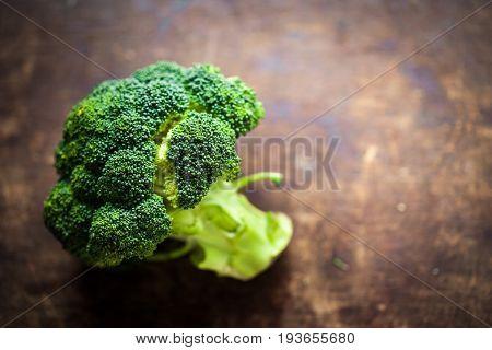 Fresh broccoli on wooden table close up. Healthy Green Organic Raw Broccoli Florets