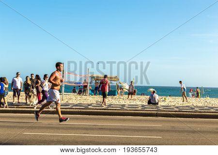RIO DE JANEIRO, BRAZIL - CIRCA JAN 2014: People doing activities in Copacabana sidewalk in Rio de Janeiro, Brazil