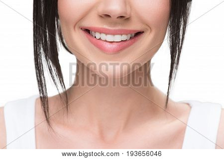 Close up of voluptuous female lips and neck. Girl has charming smile