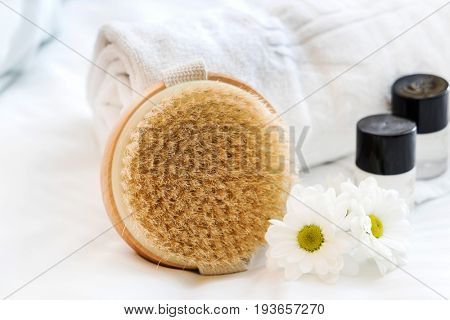 spa and beauty threatment products with white towel