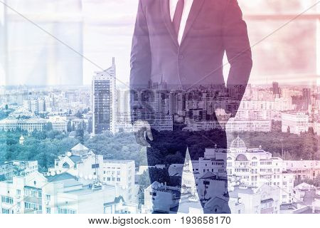 Marketing concept. Double exposure of business man and cityscape background