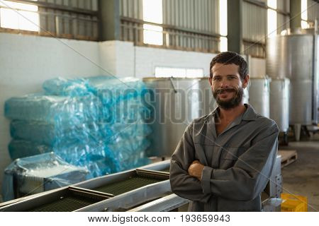 Portrait of worker standing with arms crossed in olive factory