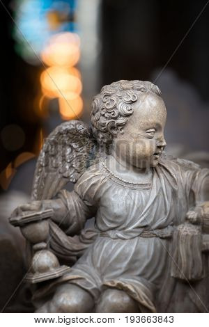 White statue of angel boy in church. Sweden Scandinavia. Europe travel.