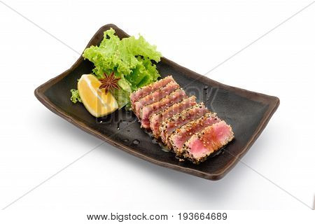 Tataki (tuna Fillet) On A Black Plate Isolated On White Background,